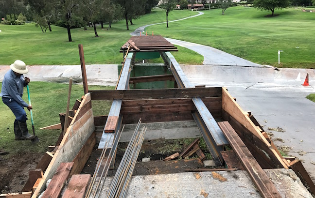 Grounds staff works to rebuild bridge at No. 1