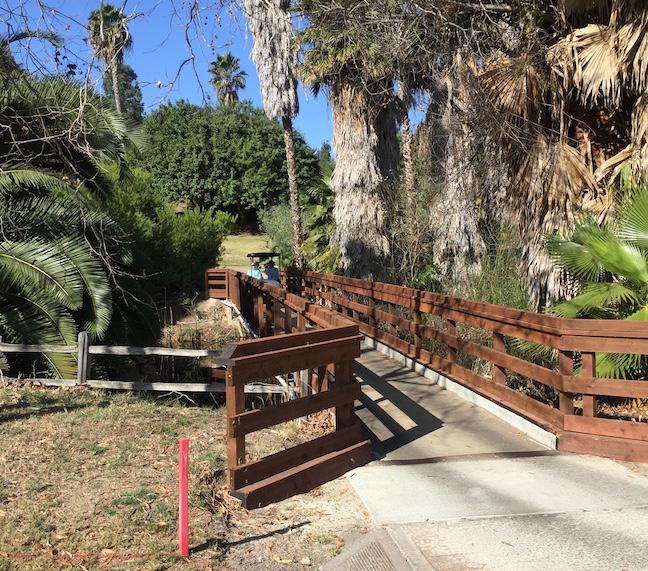 RBIWGC cart crosses bridge just off green at No. 3