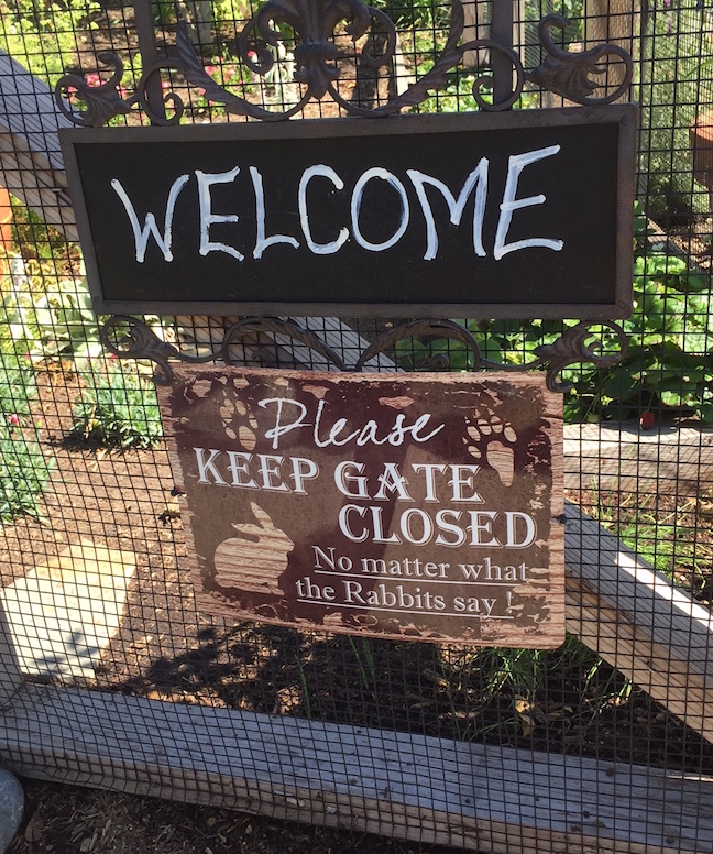 Whimsical sign asks visitors to keep garden gate closed