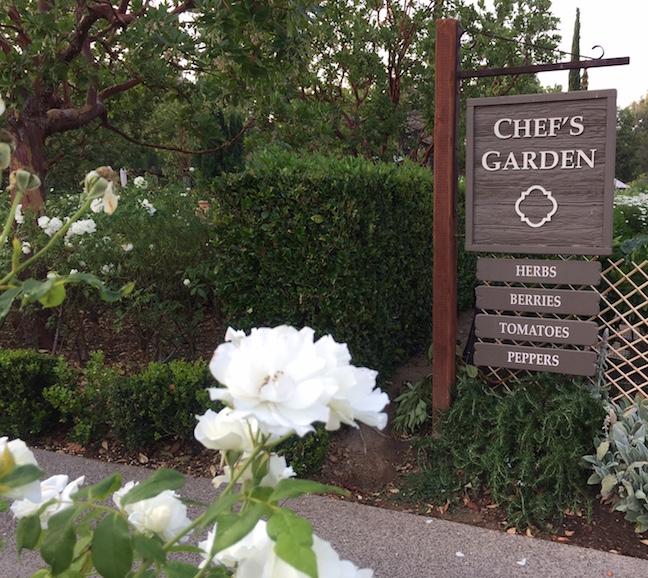 RBI's signature white roses frame Chef's Garden sign