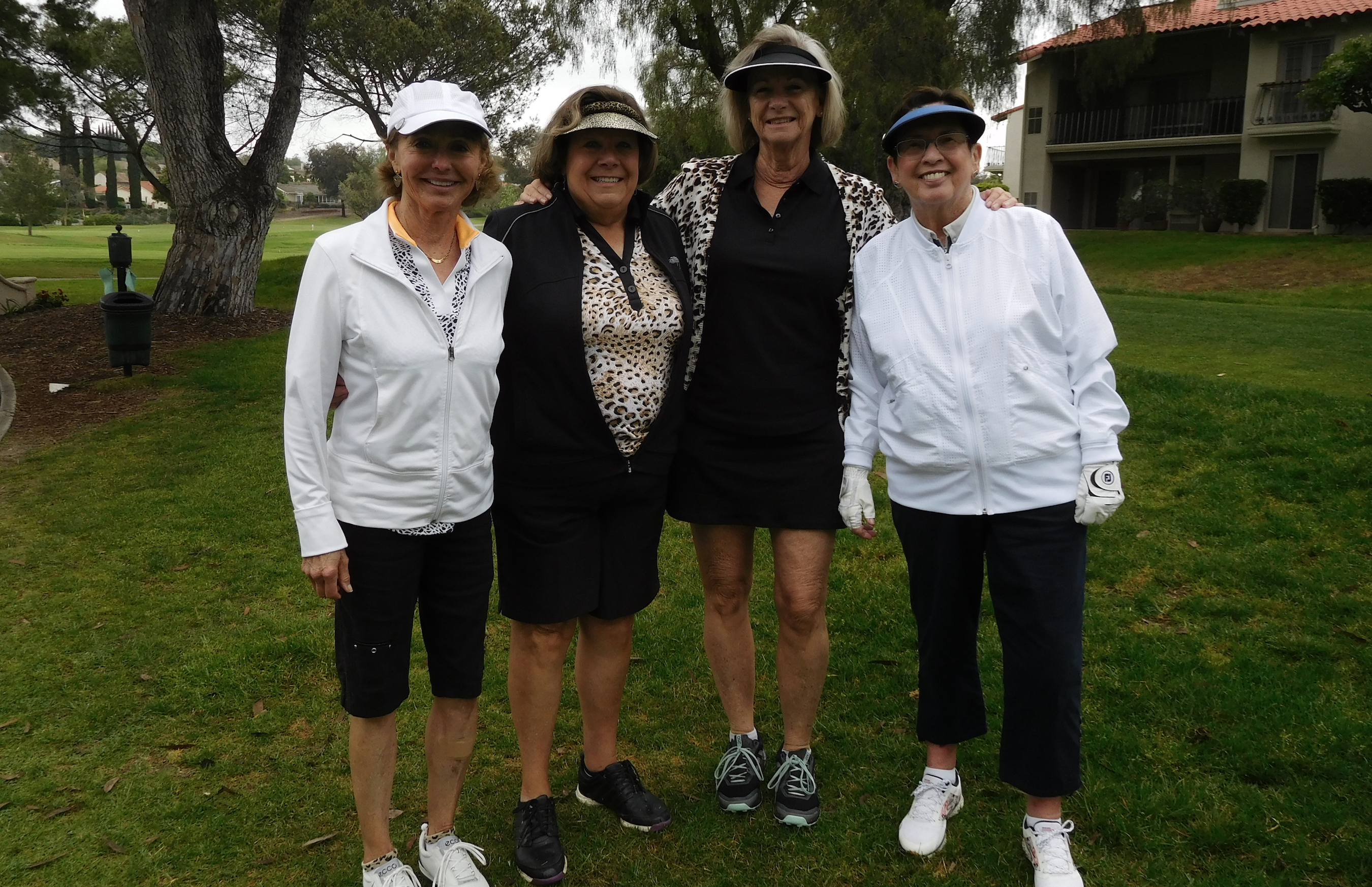 Nancy Elliott, Karen Miller, Brandie Woodfill and Kathy Auten share a laugh at tournament
