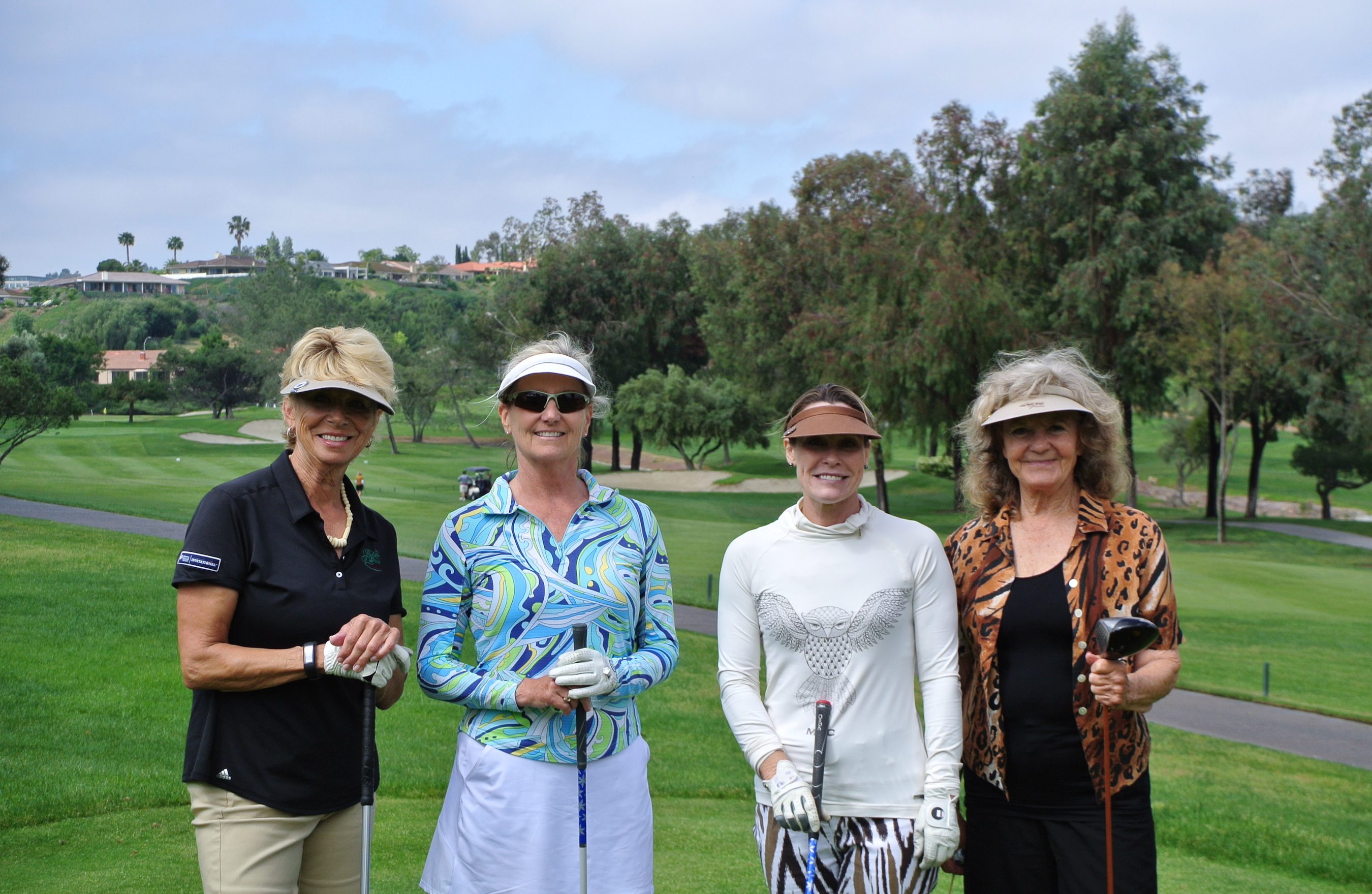 Barb Kleber, Susan Boeshart, Elna Eriksen and Betty King enjoy the sunny day at the Invitational