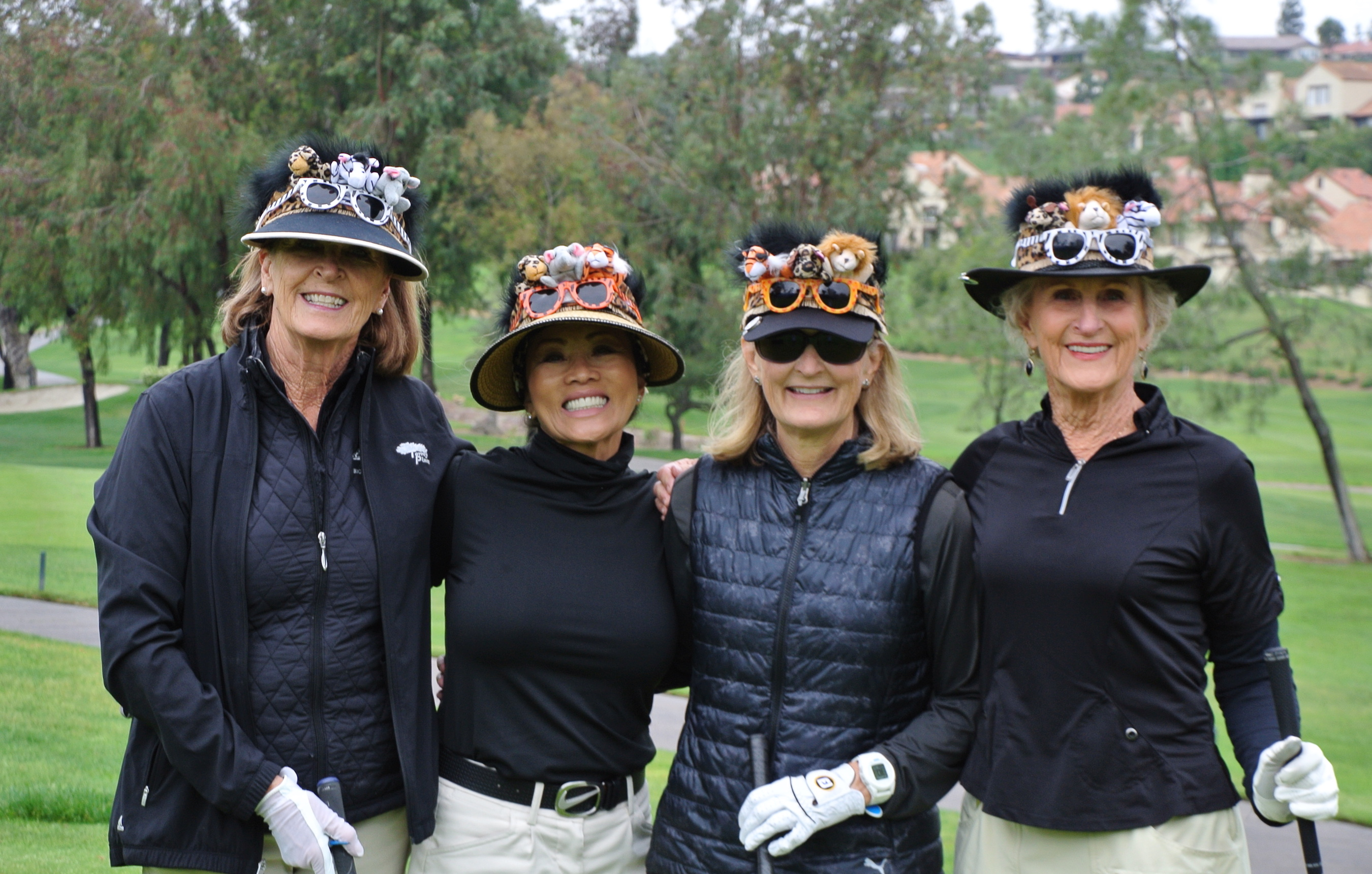 Cathy Jorgensen, Annie Governski, Kathy Kuhn and Wanna Caverly wear theme-related hatbands created by Jorgensen