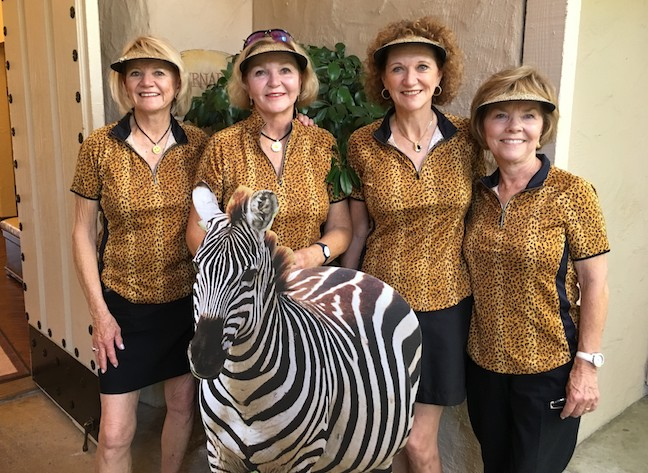 Mary Jo Rice, Diana Bolander, Donna Boyce and Terry Wade celebrate Bolander's hole-in-one on No. 13 with a friendly zebra